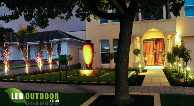 Front view of Adelaide home in evening displaying a beautiful array of LED garden lighting.