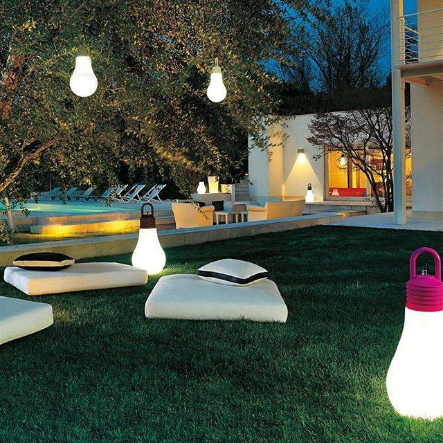 LaDina, movable LED outdoor lighting place on ground and hung from trees in backyard.