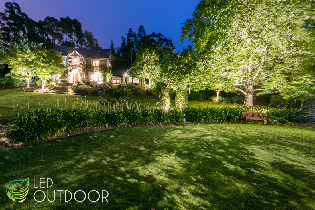 Full view of home and garden landscape lighting at night in Adelaide Hills.