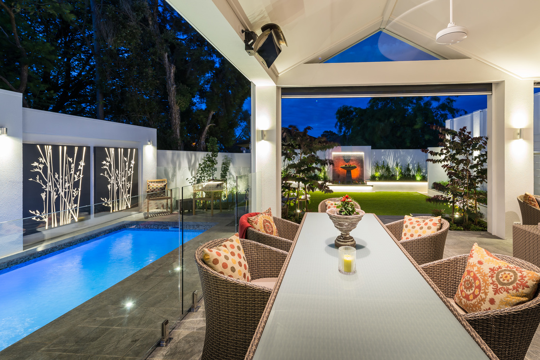 Full view of stylish outdoor living area, illuminated at night with low-voltage LED lighting and creative design.