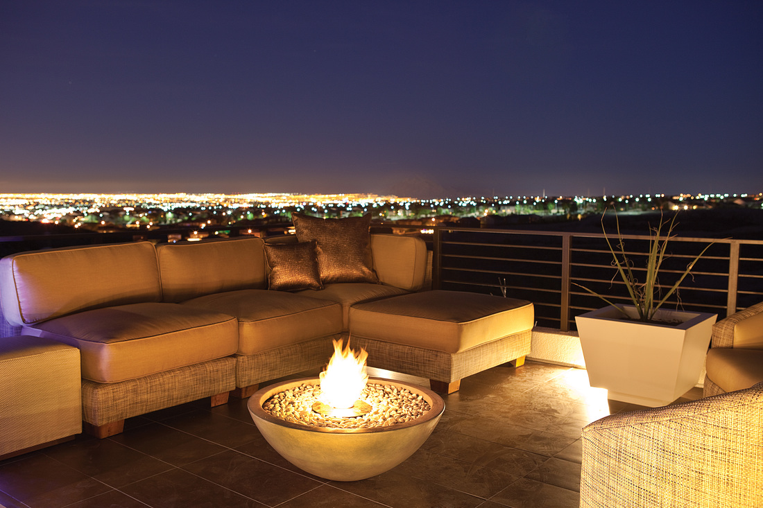 Outdoor patio illuminated with subtle LED lighting and bioethonal fire pit.